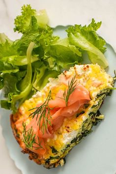 This salmon frittata breakfast or brunch recipe incorporates arugula and pesto to create the ultimate seafood dish that you can eat for any meal. Whether you're eating this seafood recipe for breakfast, brunch, a light lunch, or a savory dinner, it's a great way to incorporate salmon into any meal. The lemon adds acidity and citrus to create a bright and fresh summer recipe.#salmonrecipes #breakfastrecipes #brunchrecipes #eggrecipes #frittata #seafoodrecipes #salmon Spinach Basil Pesto, Arugula, Breakfast Frittata, Quiche, Best Brunch Recipes, Breakfast Recipes, Seafood Dishes, Seafood Recipes, Salmon Frittata