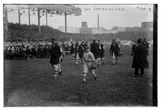 White Sox march into Polo Grounds in 1917 World Series, note jackets and Manager Rowland's son on right. Appears to be reserve catcher Byrd Lynn with large catcher's mitt, Lefty Williams to his right, Nemo Leibold with open jacket to young Rowland's right