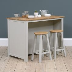 Our charming Portobello Grey Breakfast Bar Kitchen Island will bring added surface and seating space to your kitchen. With its gently oiled finger jointed oak top and soft grey painted base it will complement any decor style. The two tidy bar stools tuck under the lipped edge for more seating or to create a cosy breakfast nook while the front cupboard space offers ample room to store pots, pans and baking equipment.