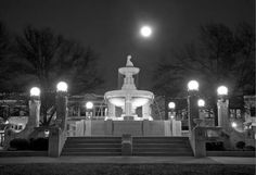 Culbertson Fountain at night, located in the center of the square downtown.