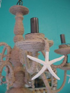 How to decorate your chandelier beach style beach chandelier cool way to beach up a chandelier mozeypictures Image collections