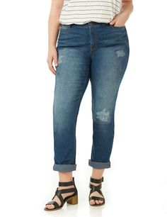 Girlfriend Jean   Catherines We love the relaxed design of our latest denim capri. Deconstructed details add a vintage feel and a roll-up leg lets you customize your look. A hidden elastic waist keeps the look comfortable. Zip opening with button closure. Five pockets. Catherines pants are specifically designed with the plus size woman in mind.
