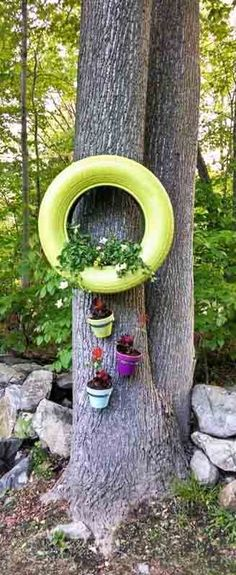 Make hanging tire planters to make your garden more beautiful. Don't miss this complete DIY tutorial on tire planters.