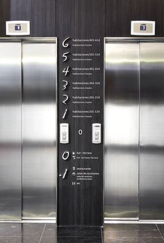Image 6 of 28 from gallery of Hotel Vincci Gala Barcelona / TBI Architecture & Engineering. Photograph by José Hevia Blach Floor Signage, Hotel Signage, Directory Design, Visual Design, Elevator Design, Elevator Lobby, Wayfinding Signs, Lift Design, Lobby Design