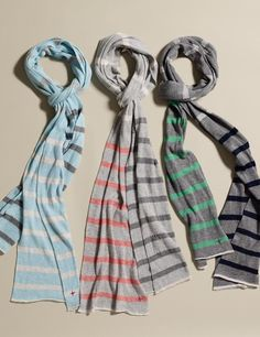 Colorful scarves... would look great with a khaki trench.