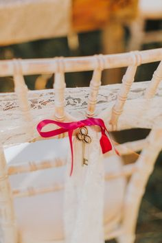 Key Lace Bow Chair Decor Alice in Wonderland Wedding Ideas http://nataliepluck.com/