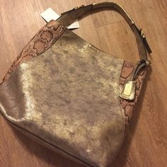 NWT Pewter and Snakeskin Bag NWT! Larger bag is gunmetal with snake print. Has inside pocket. The smaller pouch has an optional strap that can be removed. Use as a clutch, crossbody, or makeup pouch. Liz Soto Bags Shoulder Bags