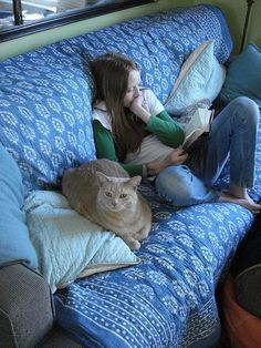 Now this is how one reads. Cuddle up on the couch with a fat kittie. by On Bradstreet via flickr. #reading