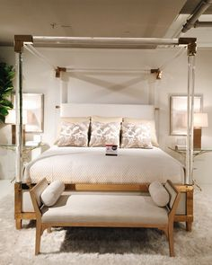 Spotted at #hpmkt! @bethdotolo's Style Spotted this jaw-dropping acrylic, brass, and white canopy bed by @bernhardtfurniture! Wow! Who is the lucky @pulpdesigns client?!? Furniture like this makes us lucky interior designers. #hpmktSS #hpmktcoveredincryptonhome