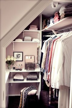 Pretty in pink! Great way to utilize awkward spaces in your home.  The angled wall is ideal for storage of accessories/folded items.  Double/long hanging rods are effective on the regular wall with higher shelving utilized for rarely worn or out-of season clothing.