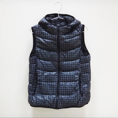 Uniqlo Ultra Light Down Vest in grey check pattern Purchased this warm down vest in Japan. It features an incredibly thin, light weight design. Made with thickly woven fabric that resists water and water-repellent thread that prevent moist from seeping through the seems. High collar, snugged fit for a slimming, feminine silhouette. Rare grey check design. Size L in Japanese sizing, equivalent to US size M. Unworn and has been stored in a close door closet. UNIQLO Jackets & Coats Vests