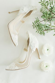 White lace Vince Camuto heels are romantic and sweet in all the right places, the epitome of a bridal footwear.