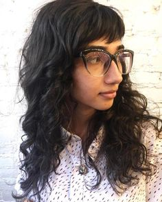 Long Curly Hairstyle With Bangs