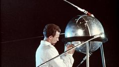 Sergei Korolev, the lead Soviet rocket engineer during the Space Race, constructing Sputnik, the first artificial Earth satellite, 1957.