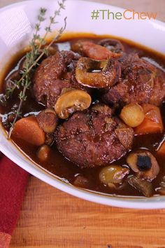 "Michael Symon takes a traditional French recipe and replaces the stew meat with chicken for a delicious Chicken Meatball Bourguignon meal that will have your children saying ""ooh la la""! #TheChew"
