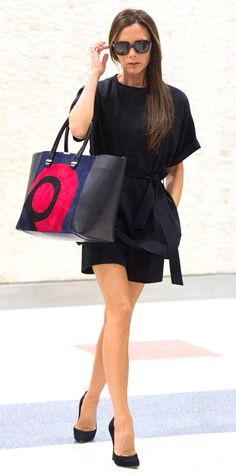 Days after she was spotted at the airport in a casual rocker-chic ensemble, Victoria Beckham embarked a flight to New York City in a classic posh LBD, complete with a colorful carryall and black pumps. #InStyle