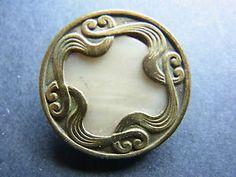 Button-French brass and MOP Art Nouveau design. Ca. 1900.