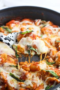 Chicken Parmesan Gnocchi Skillet is a total comfort food meal made all in one skillet. Less dishes to clean with saucy gnocchi, juicy chicken, and Parmesan and mozzarella cheeses. Top this dinnertime favorite with fresh basil for serving