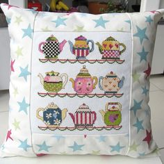 Super teapots pattern, finished to perfection as a cushion!