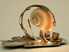 An Art Nouveau silver-plated fairy lamp by Moritz Hacker, circa 1905. From here.