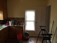 Another view of Kitchen Area, right doorway is stairwell which leads to upstairs bedrooms
