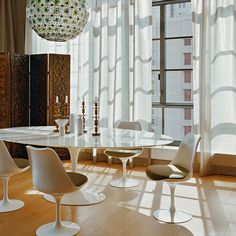 saarinen did not like all the legs underneath chairs  tables so he created the pedestal collection.