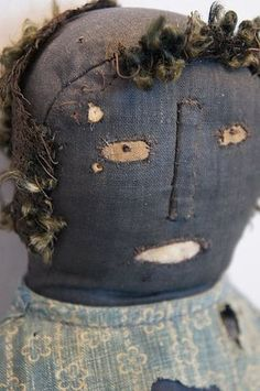 Great primitive antique black cloth doll with applied nose