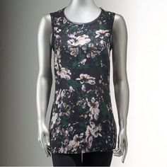 NWT. Drape-back sleeveless printed top NWT. Simply Vera Wang. Drape-back sleeveless top. High-low hem, scoop neck with button back closure. Very nice and elegant floral print. Sorry, no trades. Like the item but not the price, feel free to make me a reasonable offer using the offer button below. Simply Vera Vera Wang Tops