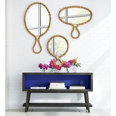 The mirrors are from CB2 but I'm more interested in the little sideboard below!