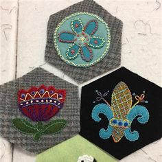 works in progress from the Saturday Stitching Society... -- Embroidery on Wool Applique