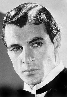 Gary Cooper, 1931 - Did they wear makeup in 30's? Look at his eyebrows & eyes? Quite striking back then...wasn't he!
