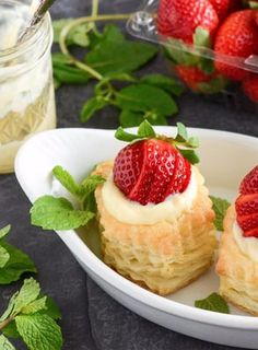 Berries & Cream in Puff Pastry - Gorgeous puff pastry is filled with chilled vanilla pastry cream and topped with sweet strawberries! Perfect make-ahead light dessert for a dinner party. Prep and cook time is quick and easy - only takes about 20 minutes; however, these yummy sweet treats need to chill for 2 hours before serving.
