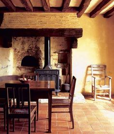 Beautifully rustic.  How great would it be if the wall behind the wood stove held a pizza/bread oven...
