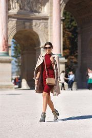 This super cute mini trench is another gorgeous example of the trench coat franchise. Larisa Costea looks stylish and feminine in this beige coat, paired with some glammy glittery heels and a classic scarlet dress! Dress: AX Paris, Trench Coat: Zara, Bag: Michael Kors, Boots: Little Mistress.