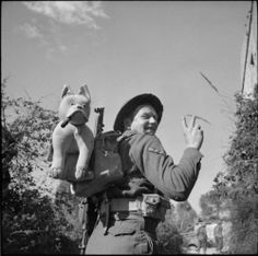 L/Cpl J Leigh of the Seaforth Highlanders with his mascot, Churchill, that he carried throughout the duration of the Italian campaign, February 1944