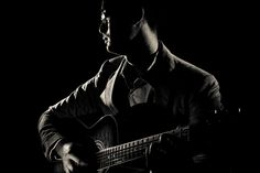 Guitarist in low key photography