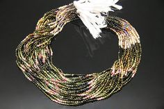1strand  natural multy tourmaline plain ball sized 2.5mm by 3yes