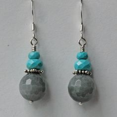 """Faceted 12mm rounds of eagle eye jasper contrast with faceted turquoise roundels. Sterling silver french hook ear wires, 1 1/2"""" long."""