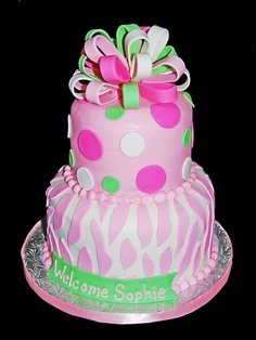 pink and green zebra print and polka dot baby shower cake topped with a mutlicolored bow by Simply Sweets, via Flickr