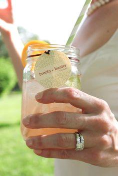 Mason Jars as cups, cute straw, orange, and super cute tag.  love it.