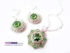 Peridot green Swarovski set.  Medallion is made with 12 mm Swarovski rivoli crystal, 4 mm Swarovski crystal bicone beads and silver plated findings.