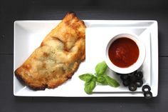 Paleo Calzones - grain-free, sugar-free, dairy-free, made with herbs, marinara sauce, and spinach!