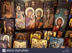 Download this stock image: Shop selling religious icons, paintings and pictures in Monastiraki, Athens. Largest denomination is the Greek Orthodox Church. - C86NPJ from Alamy's library of millions of high resolution stock photos, illustrations and vectors.