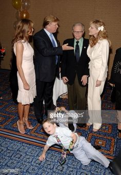 Melania Trump Donald Trump Larry King and Shawn King with King children in foreground