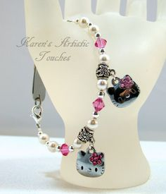 Karen's Artistic Touches Store - Hello Kitty Charm Swarovski Pink White Pearl Medical ID Replacement Bracelet, $15.99 (http://www.karensartistictouches.com/hello-kitty-charm-swarovski-pink-white-pearl-medical-id-replacement-bracelet/)