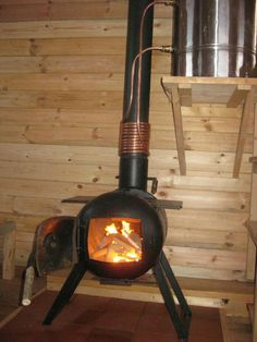 Homemade wood stove and hot water tank/pump:                                                                                                                                                                                 More