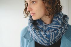 Trapped bar stripes break up the zig-zagging pine boughs that run the length of this oversized cowl. It's large enough to wrap around your head twice to keep your neck nice and cozy, but it drapes nicely and really shows off the stitch pattern when simply worn down.