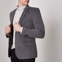 Woven fabric Muscle fit Notch lapels Chest welt pocket Front flap pockets Long sleeve Single back vent Two button fastening Our model wears a UK 40 regular and is 186.5cm/6'1.5'' tall