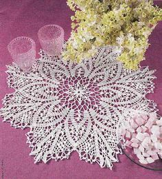 Beautiful doily, diagram only (German). Measures 44 cm = 17.32 inches. On diagram: Big circle is popcorn stitch, small circle is picot stitch.