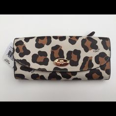 """NWT COACH Leopard Wallet This is a cute coach wallet with the leopard print. Twelve credit cards could fit in and there are multifunction pockets (full length bill compartments). There is also a removable zip pocket at the back of the wallet. Size: 8""""✖️3.5"""" Coach Bags Wallets"""
